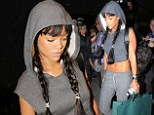 Double trouble! Rihanna shows off slim and taut midriff in shrunken hoodie and wears long brunette mane in youthful braids