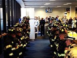 Show of respect: MassPort firefighters lined up Thursday at Logan Airport to greet the family of fallen comrade Lt. Ed Walsh, who died the prior day battling a massive blaze in the Back Bay neighborhood of Boston