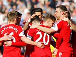All together now: Southampton bask in the sun after Lambert (right) doubled their lead