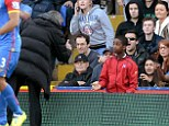 Frustrated: Chelsea boss Jose Mourinho appeared to confront a Crystal Palace ball boy during his side's defeat