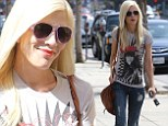 Tori Spelling displays her skinny frame in T-shirt and ripped jeans on lunch outing in Los Angeles