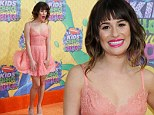 Lea Michele has a Marilyn Monroe moment as her peach dress blows up on the special orange carpet at Kids' Choice Awards