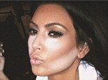 Not ready for her close up! Kim Kardashian shares snap of her two-tone face as she uses make-up contouring trick