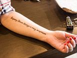 Tattoo you: Eugene Tolkacheva, 28, got a tattoo proclaiming her pledge. The bizarre campaign is in response to American sanctions on some of Russia's rich and powerful