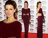 Cut out queen: Kate Beckinsale showed the perfect amount of skin her sophisticated maroon gown