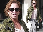 Rourke who's walking! Mickey looks in fine form as he goes for a stroll in Beverly Hills