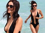 Model Kira Dikhtyar suffers wardrobe malfunction in VERY risque swimsuit... after claiming 'bully' Naomi Campbell left her psychologically damaged