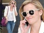 She's setting the standard! Reese Witherspoon wears youthful white blazer and tight denim jeans while leaving her office