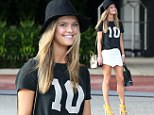 Perfect 10! Sports Illustrated model Nina Agdal gets top marks as her endless legs wow in white miniskirt