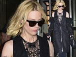 January Jones pushes the fashion envelop for second day in a row as she steps out in a cut-out trench and lacy pantsuit