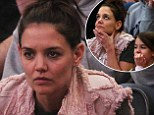 Katie Holmes goes make-up free to bring her mini-me daughter Suri Cruise to a college basketball game in NYC