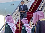 Arrival: In this March 28, 2014, photo, President Barack Obama walks down the stairs of Air Force One during his arrival at King Khalid International airport in Riyadh, Saudi Arabia