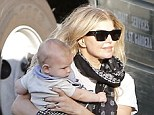 Fergie and husband Josh Duhamel wear rocking band shirts to collect son Axl from their LA babysitter