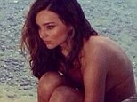 Shedding her inhibitions: Miranda Kerr, pictured on a photo shoot earlier this month, has hinted she's now open to a relationship with both men and women