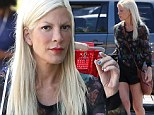 Frugal shopper: Tori Spelling took the family shopping on Sunday at a consumer-friendy Target chain store