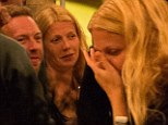 Gwyneth Paltrow spotted for first time since marriage split without her wedding ring... but proves it's amicable as she cracks up at Chris Martin's jokes