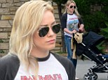 Rock on! Hilary Duff shows off her edgy side in Iron Maiden blouse and skin-tight ripped jeans while strolling with son