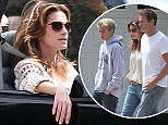 Soaking up the California sun! Cindy Crawford took a joy ride in a convertible truck with her husband Rande Gerber and son Presley in Malibu on Saturday