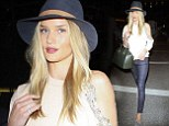 Rosie Huntington-Whiteley looks fresh faced AND super stylish in off the sholder top and skinny jeans  as she jest across the Atlantic