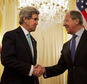U.S. Secretary of State John Kerry, left, shakes hands with Russian Foreign Minister Sergey Lavrov before the start of their meeting at the Russian Ambassado...