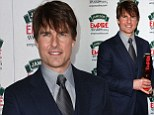 Tom Cruise cuts a dapper figure in an immaculate navy suit as he is named Legend Of Our Lifetime at the 2014 Empire Film awards