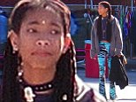 Willow Smith embraces bohemian style in tie-dye flared trousers and waist length braids