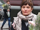 Spring fever: Helena Christensen picked up some flowers on a dreary Sunday in New York City