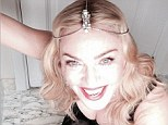 'Laughing at all the haters!' Madonna sports fishnets and ample cleavage as she calls out those who try 'to limit and label me'