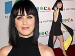 Showing him what he's missing! Katy Perry flashes leg in futuristic-inspired ensemble following her split from John Mayer