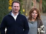 Geri Halliwell links arms with her new man Red Bull Racing Formula One Team Principal Christian Horner as they enjoy a romantic stroll