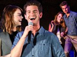 Having fun in the dark! Emma Stone and boyfriend Andrew Garfield cannot stop giggling at each other as they launch Earth Hour