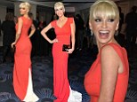 Singer Sarah Harding looks stunning in red gown at the Empire film awards