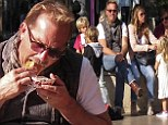 Kevin Costner indulges in a hot dog at LA's The Grove alongside his family