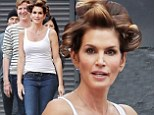 Caught off guard? Cindy Crawford was seen with a head full of curlers during a photo shoot for her Meaningful Beauty line in Los Angeles on Friday
