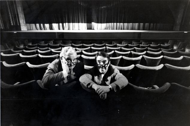 Comedians Ronnie Barker and Ronnie Corbett pictured sitting in a theatre in 1977