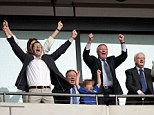 Finally something to smile about: The Ferguson clan rise in unison after Peterborough went 2-0 ahead