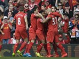 Top boys: Liverpool went top of the Premier League with a win against Tottenham Hotspur