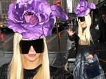 Blooming awful! Lady Gaga sports enormous purple flower headdress as she pops out for dinner in New York