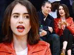 Lily Collins steals attention in orange leather as she sits courtside with male friend at Lakers basketball game