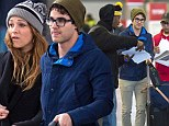 Glee's Darren Criss makes time for fans after touching down at JFK airport in New York Friday with girlfriend Mia Swier