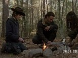 Ready to walk: Carl, Rick and Michonne tuck into a meal before their final push to make it to Terminus