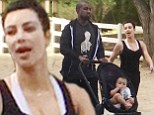 Is that really you Kim? Kardashian goes make-up free for dressed down family stroll with Kanye West and baby North