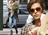 A blooming beauty! Eva Mendes juggles an enormous armload of floral arrangements