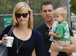 Reese Witherspoon goes casual in comfy printed trousers as she jets out of Miami with her brood for a family holiday