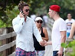 Well, this is awkward: Patrick Schwarzenegger and Jason Kennedy accidentally ended up holding hands when they bumped into each other in Miami, Florida, on Saturday