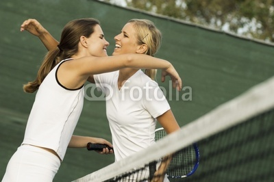 Tennis Players Hugging Each Other over net After Match