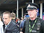 Copper: Franck Ribery is manhandled by a policeman as he leaves Manchester airport