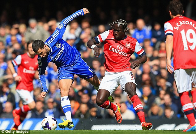 Gunning for it: Bacary Sagna, battling Eden Hazard, may move to one of Arsenal's Premier League rivals