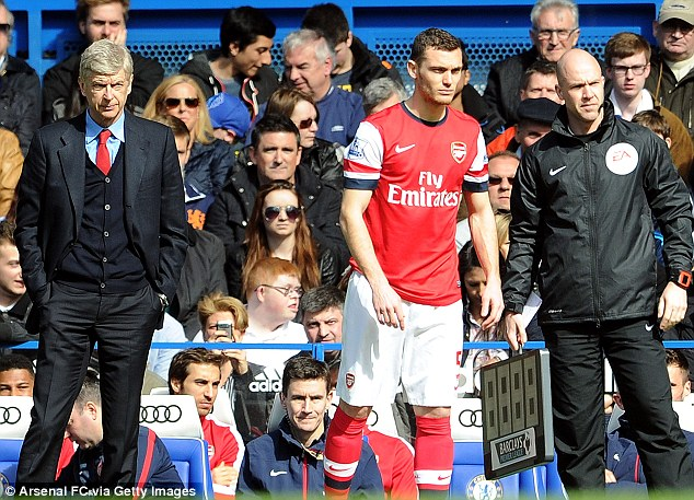 On the sidelines: Gunners defender Thomas Vermaelen could provide a short-term solution for David Moyes