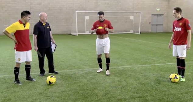 Tucked away: Giggs (second right) tries to perform one of the skills set by the freestyler (far left)